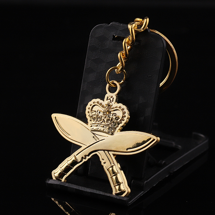 Cheap high quality custom zinc alloy gold crown double blade keychain