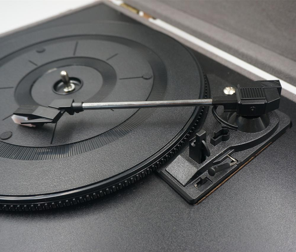 Portable 3-speed turntable with USB to PC encoding and BT for home