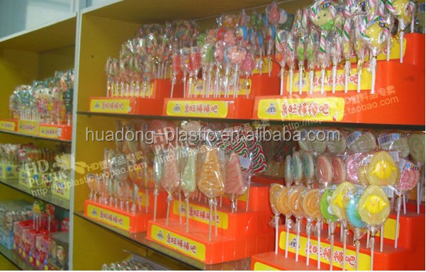Good price plastic lollipop/candy display shelf/stand