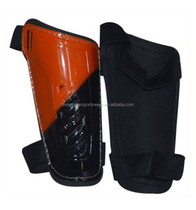 Orange and Black Leg Guard Stay Shin Pads Carbon