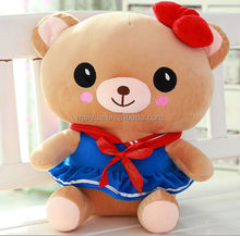 Cute Female Teddy Bear Stuffed Toy Wearing Red Ribbon and Blue Skirt