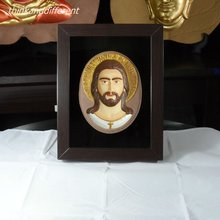 JESUS , the divine son of God , is sculpted on a sandstone radiance , the face 3D , HANDMADE SANDSTONE ART