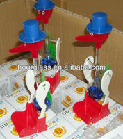 drinking bird, drinking lucky bird, blown glass drinking bird