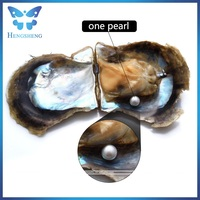 high quality white AAA+ 7-8mm near round seawater pearl oyster in vacuum packaging