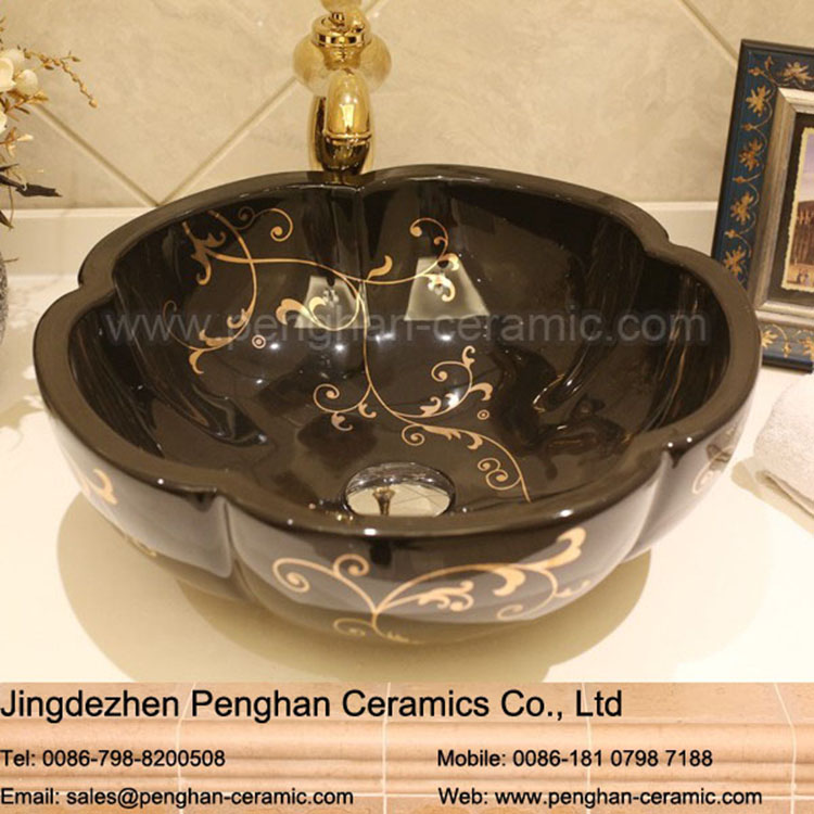 China factory direct black above counter ceramic copper feeling wash basin