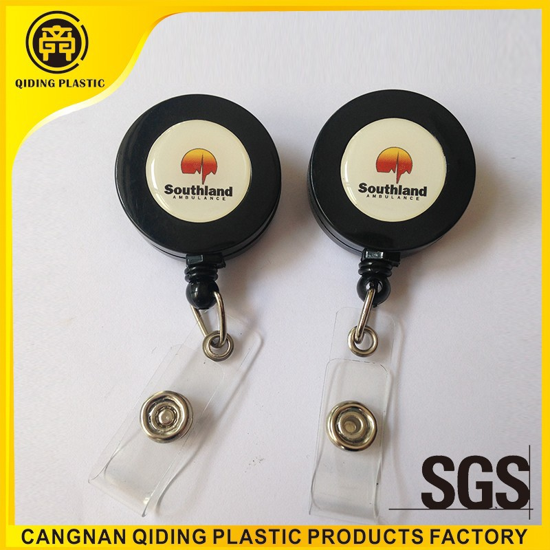 Retractable pull reel for id card badge holder