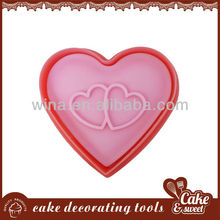 Heart-shaped plastic cookie cutter stamp