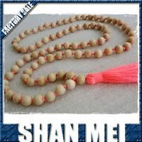 coral tassel necklace - pale wooden bead tassel necklace with a neon coral tassel