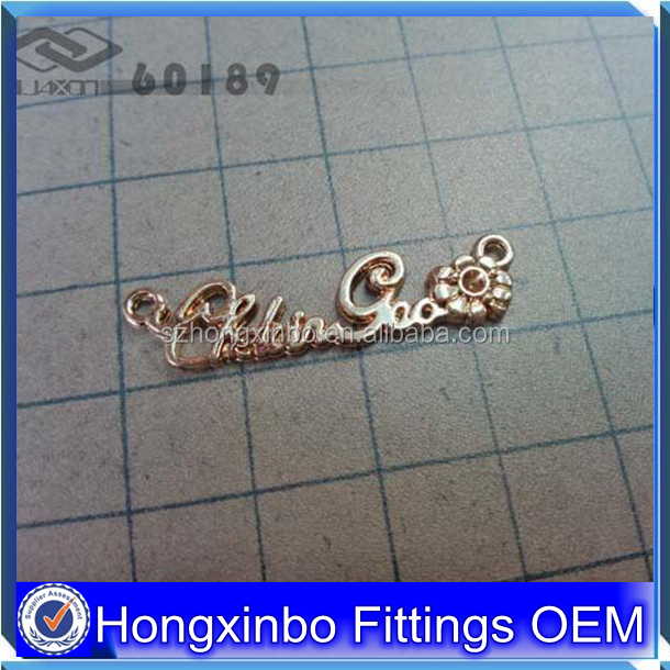 Hongxinbo Manufacturer custom various patterns metal letter logo for bag
