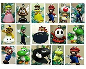 Nintendo Super Mario Brothers 19 Piece Deluxe Holiday Christmas Tree Ornament Set Featuring Unique Wooden Bomb Ornament, Princess Peach, Yoshi, Mario, Luigi, Bullet Bill, Donkey Kong, Lakitu Spiny, Shy, Toad, Koopa, and Goomba Ornaments