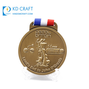 China manufacturer custom metal welding embossed 3d gun logo medal trophies cups with fabric ribbon