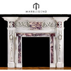 An antique fireplace surround in the manner of William Kent traditional marble fireplace