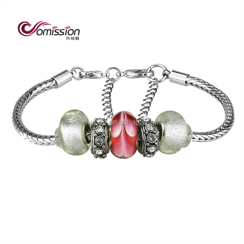 Murano Style Glass Beads and Charm Bracelet offers elegant old-world features