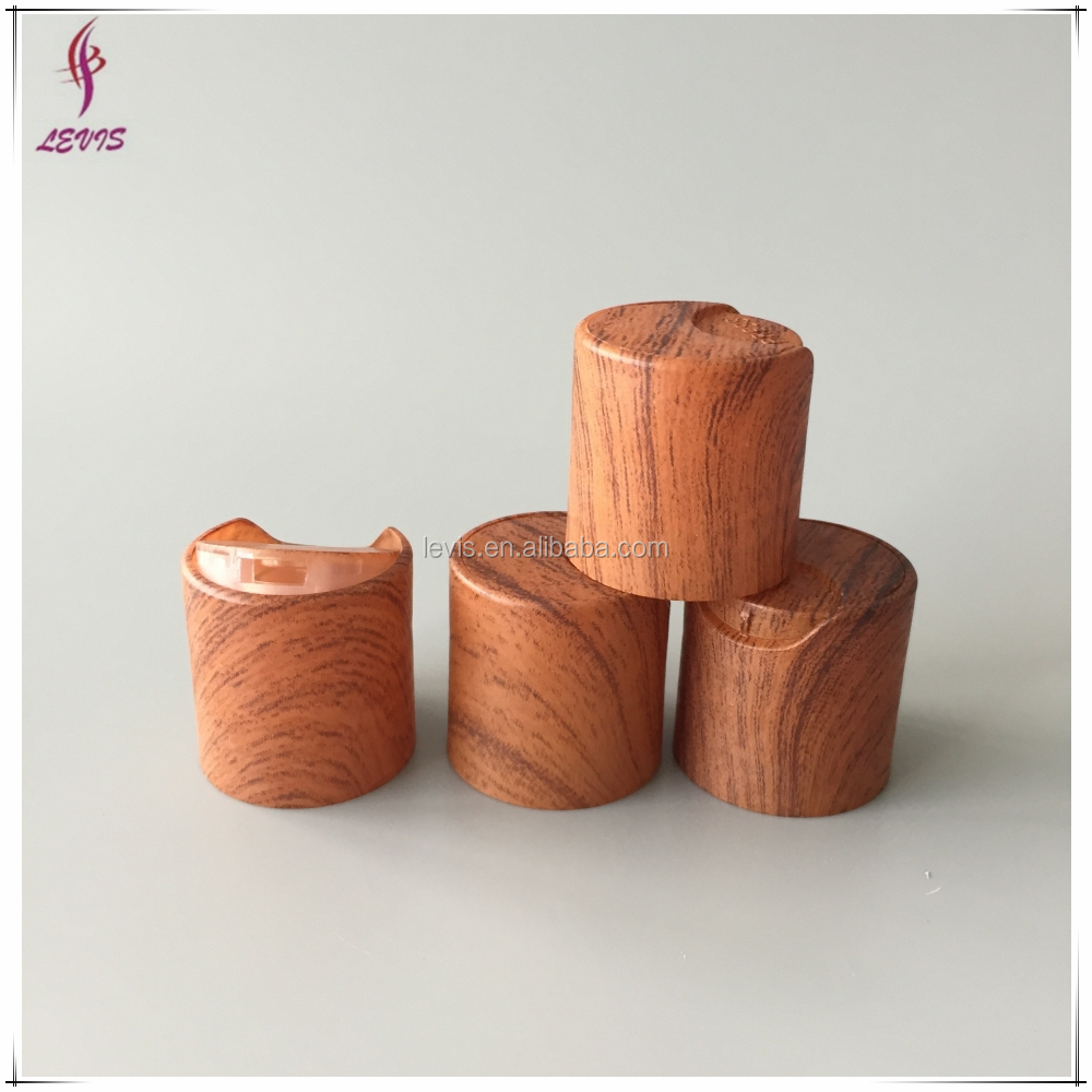 Special wood grain plastic shampoo disc top cap