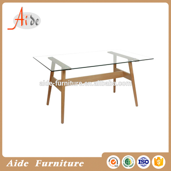 Modern design tempered glass top dining table with wood leg