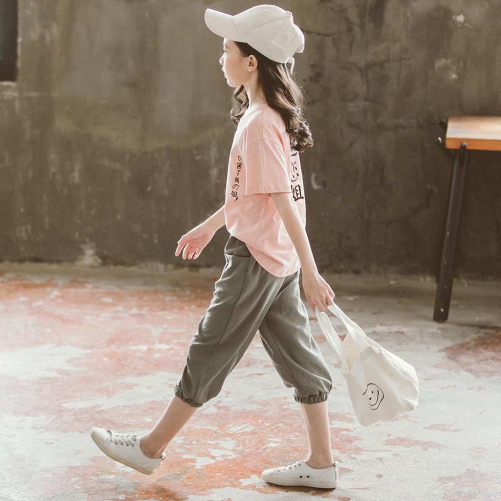 Adolescente niños chándal chicas chino japonés texto T