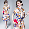 Spot QP3138073 Europe and the United States new palace wind round neck bow tie printed short-sleeved high waist dress