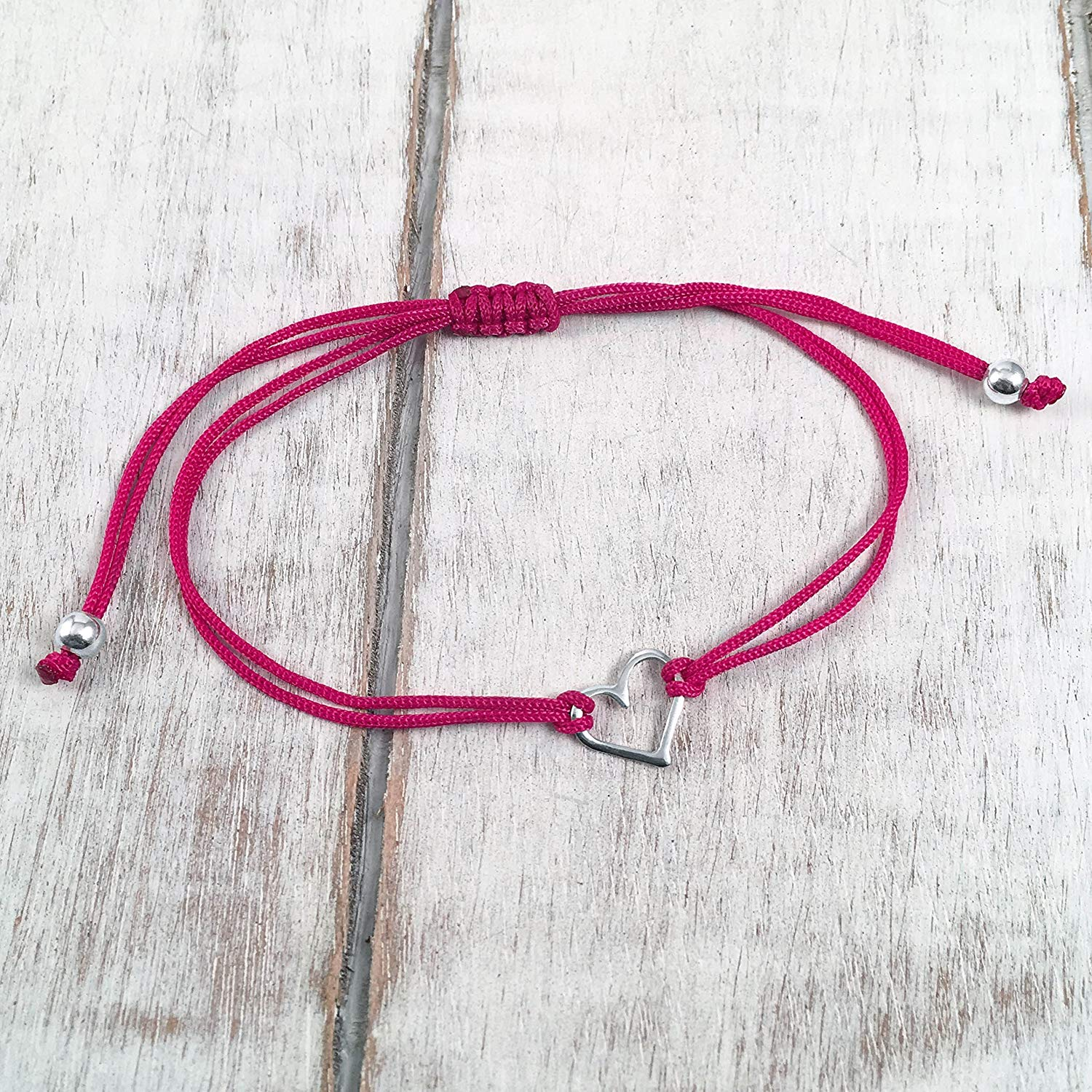 Fuchsia Pink, Small Sterling Silver Open Heart Shaped Charm Bracelet, Friendship Bracelet Adjustable Thread Cord, Handmade in Peru by Claudia Lira. Perfect for a Small Gift