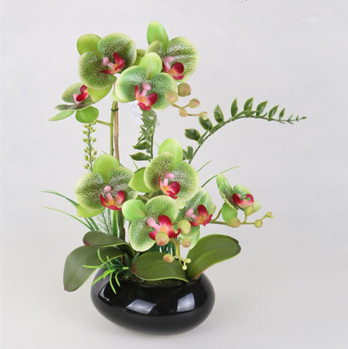 Artificial real touch green orchids with grass in black ceramic pot