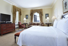 luxury hotel furniture room suite with bedding sheet