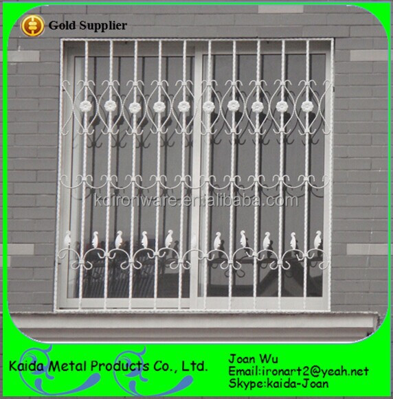 New wrought iron steel window grills grates design for Iron window design house