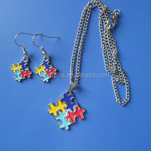 Autism awareness puzzle shaped metal necklace and earring