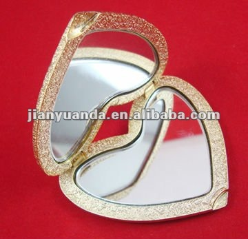 Dental heart shaped plastic make up mirror with shiny metallic golden color