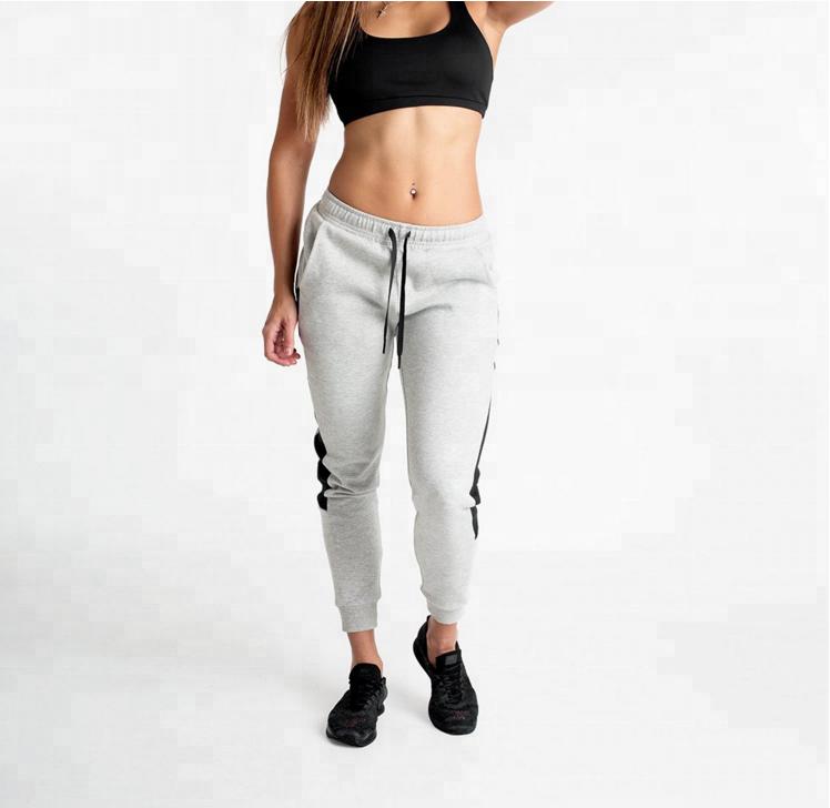 Kundenspezifisches Logodruckfrauenbaumwolljoggerhose bodybuilding Schweißhose laufende Böden Großverkauf