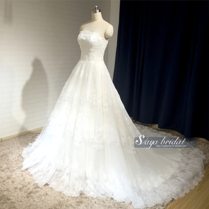 Strapless long tail lace beaded wedding dress with bondage
