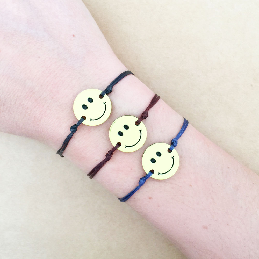 Young girl's stainless steel gold plated smile charm emoji cord bracelet