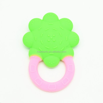 Healeanlo BPA Free silicone sunflower shape baby teething pacifier best  teether for 3 month old help 28c71cbff