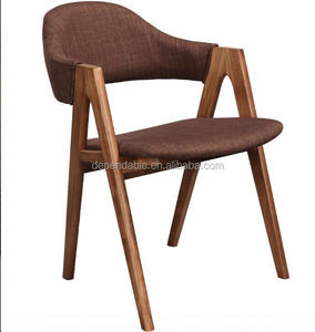 Timber armrests Sergio Dining Chair with a hint of retro
