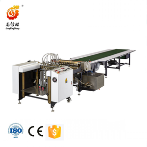 Box paper gluing machine with feeder