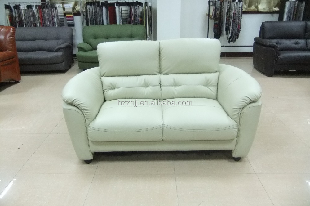 Pu leather sofa chic home winston gold nailhead trim on for Sofa chair malaysia