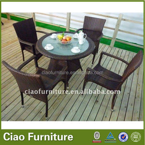 outdoor wicker round glass dining table set stackable rattan arm chair