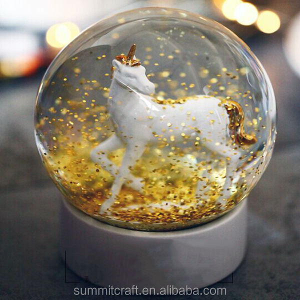Custom unicorn snow globe with gloden blowing snow