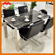 Marble top dining table cutted by elegant black marble stone silver dragon