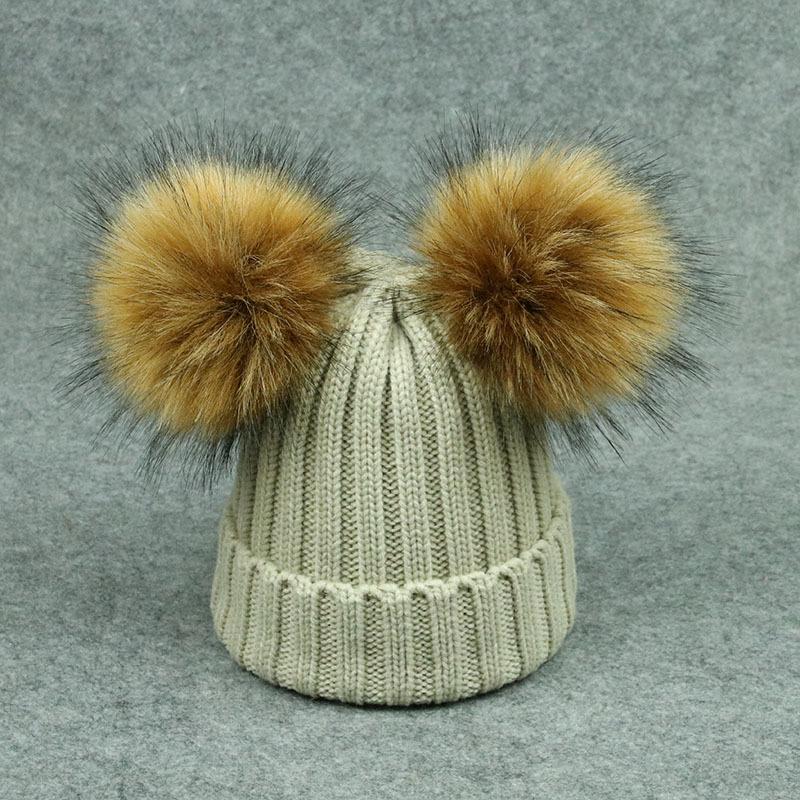 b6f17ece8e4 High quality winter knit hat with raccoon fur ball on the top Fax fur pom  pom custom winter hats plain beanie hat