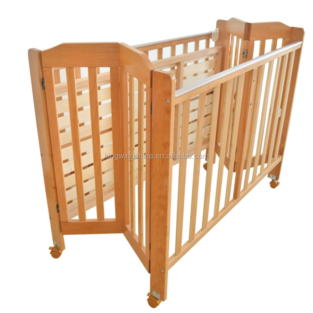 Foldable Solid Wooden Baby Crib With Castor Buy Natural