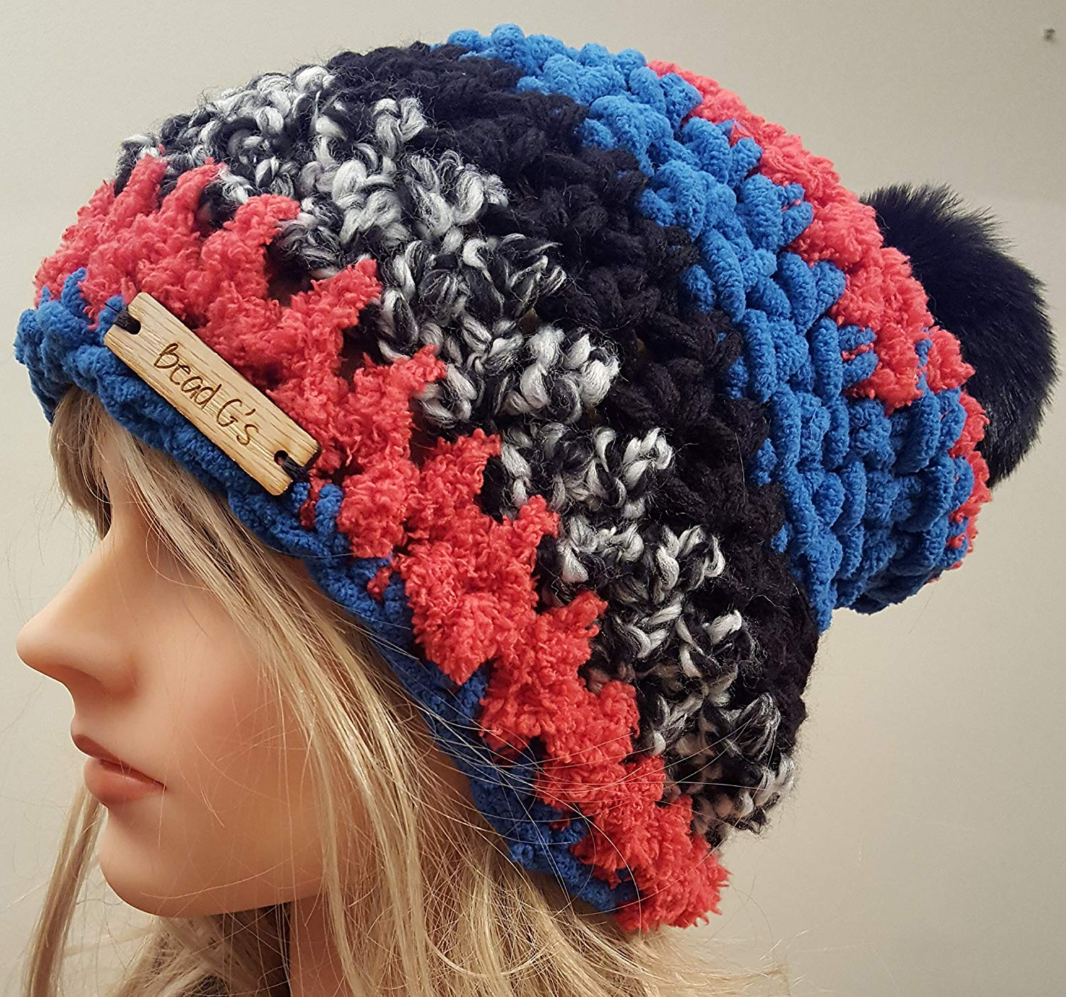 01503b85a3d Get Quotations · Crochet Blue and Red Fuzzy Pom Pom Hat. Made By Bead G s  On AMAZON