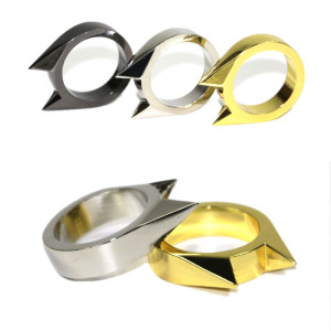 silver and gold cat ear self defense ring