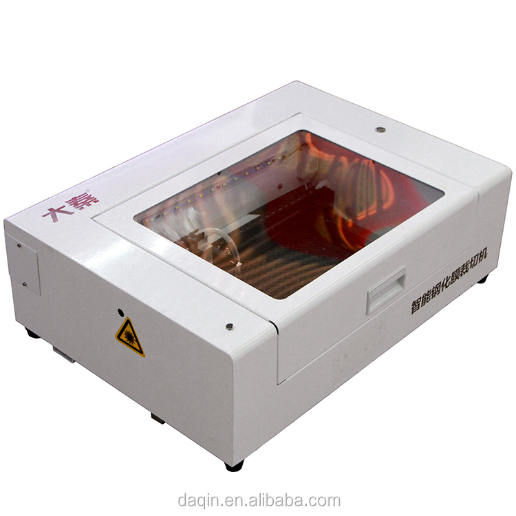 DAQIN screen protector <strong>laser</strong> making / cutting machine for any mobile phone