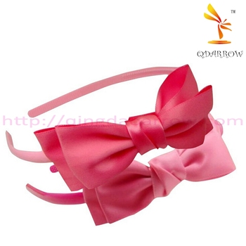 Plastic pink headbands for girls with bow