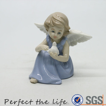 Ceramic holding bird sitting little angel statue with blue dress