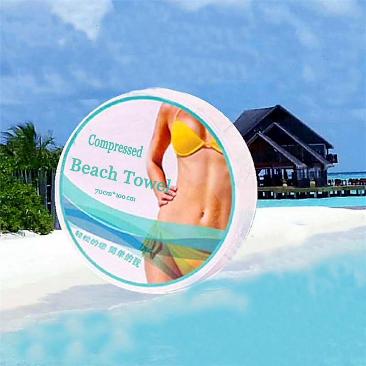 Promotional gift Nonwoven Fabric Disposable Compressed Beach Towel 100 Cotton Bath Towel For Travel Hotel