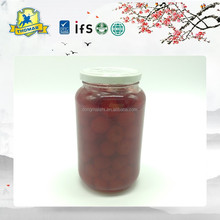 Fresh fruit style canned cherries in glass jar