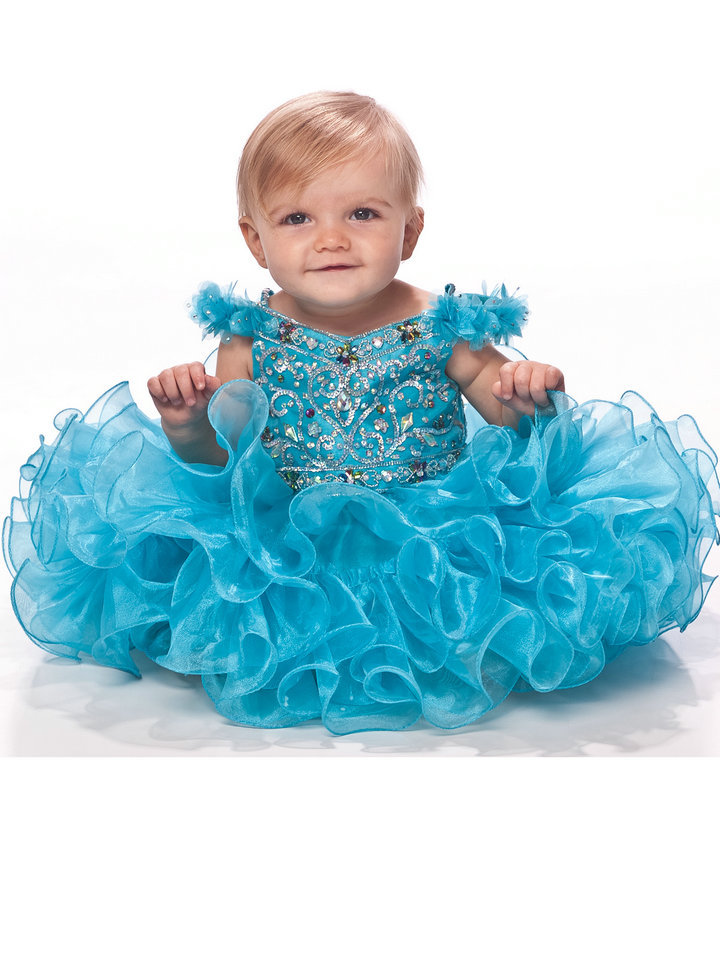 Cute babies in blue dress