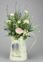 PINK/LAVENDER RANUNCULUS & LAVENDER ARRANGEMENT ON ROUND IRON PITCHER