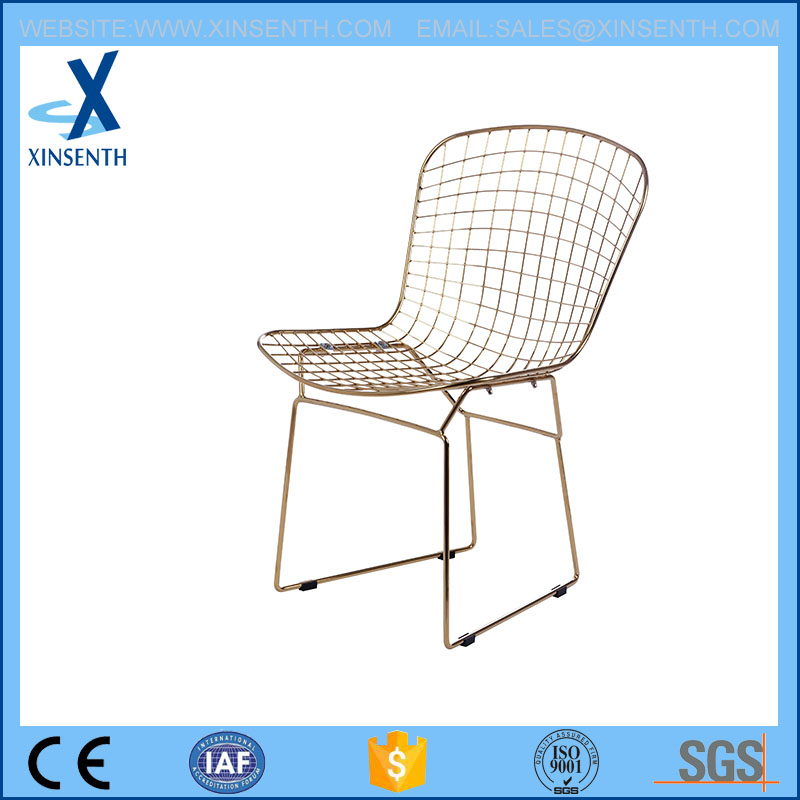 golden chromed wire mesh chair