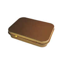 golden and silver cigarette tin box
